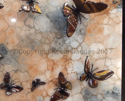 Brown butterfly art on a stone effect background