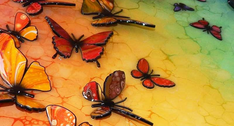 butterflies in rainbow colour sitting on picture