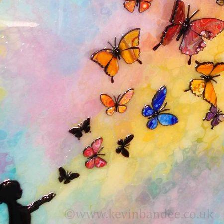 child releasing butterflies