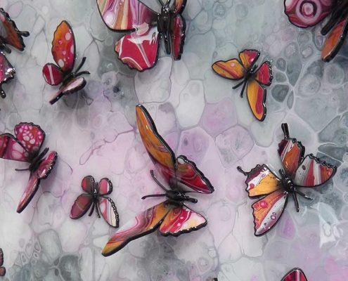gold and pink butterflies side view