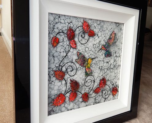 Side view of framed hummingbird art
