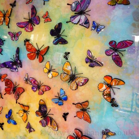 lots of colourful butterflies side view
