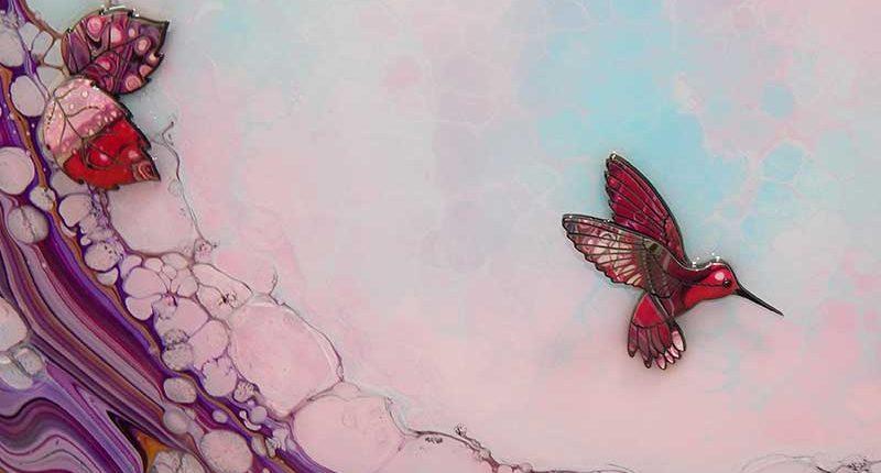 pink hummingbird on light blue pink background