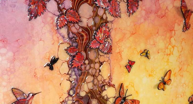 red brown tree with hummingbirds