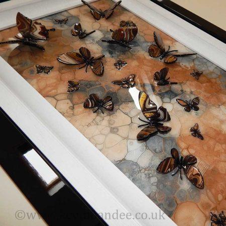 side view brown stone multi butterfly art